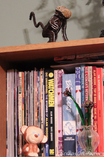 Another shelf holds a beaded monkey we bought at Animal Kingdom and the little monkey figure I painted at Firefly Pottery.