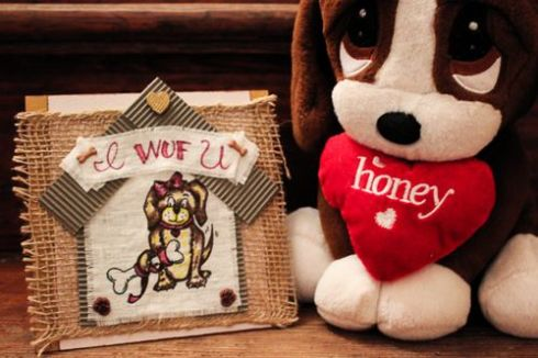 """Not that stuffed pup, but another one I gave Todd on our first Valentine's together says """"I wuf you"""" and blushes when you squeeze it."""