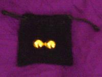 24k gold coated ben wa balls with their black velvet storage bag