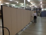 2 9 panel room dividers connected to create a long continuous wall