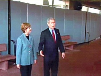 President and First Lady Bush speak to guests at an airport in front of a wall of Screenflex Room Dividers