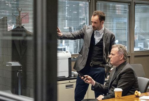 Holmes and Gregson analyze. Image © CBS