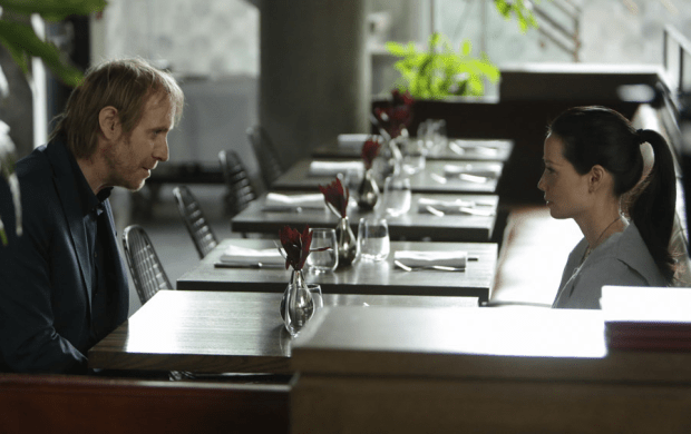 "Rhys Ifans and Lucy Liu in Elementary's ""The Man with the Twisted Lip."" Image © CBS"