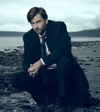 David Tennant as Detective Emmett Carver