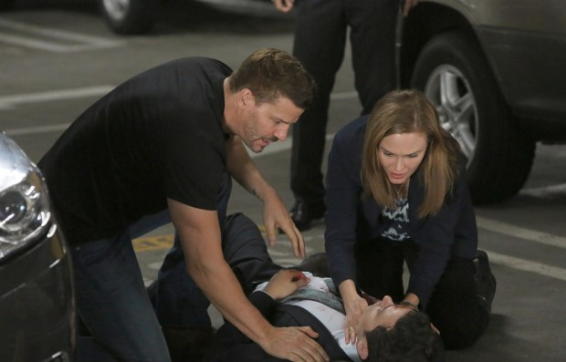 Brennan (Emily Deschanel, R) and Booth (David Boreanaz, L) are shocked to see the Sweets (John Francis Daley, C) has been shot. Co.  Cr:  Patrick McElhenney/FOX
