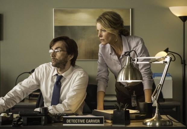 Detectives Ellie Miller (Anna Gunn, R) and Emmett Carver (David Tennant, L) examine a piece of evidence. Co. Cr: Ed Araquel/FOX