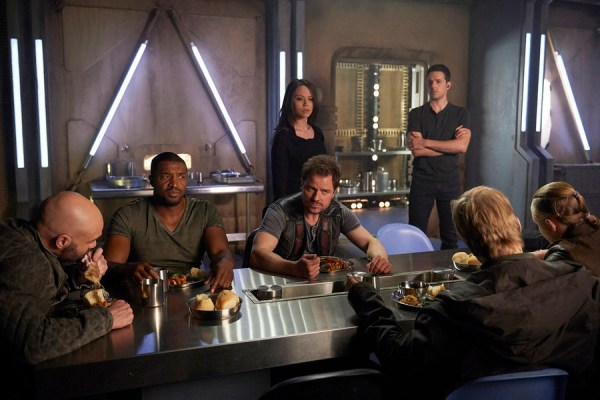 Pictured: (l-r) Roger Cross as Six, Anthony Lemke as Three, Melissa O'Neil as Two, Mark Bendavid as One -- (Photo by: Russ Martin/Prodigy Pictures/Syfy)