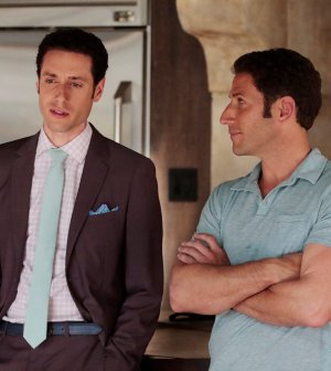 Pictured: (l-r) Paulo Costanzo as Evan Lawson, Mark Feuerstein as Dr. Hank Lawson -- (Photo by: Giovanni Rufino/USA Network)