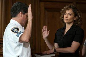 "SHADES OF BLUE -- ""Eye of the Hurricane"" Episode 202 -- Pictured: (l-r) Raul Reyes as Bailiff, Jennifer Lopez as Det. Harlee Santos -- (Photo by: Peter Kramer/NBC)"