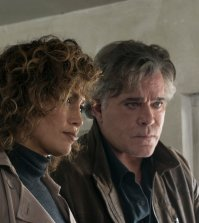 "SHADES OF BLUE -- ""Unpaid Debts"" Episode 208 -- Pictured: (l-r) Jennifer Lopez as Harlee Santos, Ray Liotta as Lt. Matt Wozniak -- (Photo by: Peter Kramer/NBC)"