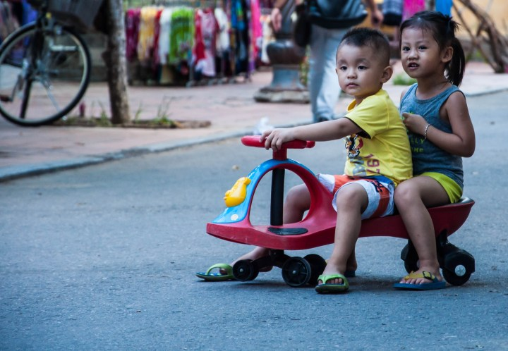 These two are one of the cutest kids we saw in Vietnam. They were trying to cross the busy street in the Hoi An Old town on their scooter. I clicked this while the kid was waiting for a scooter to pass
