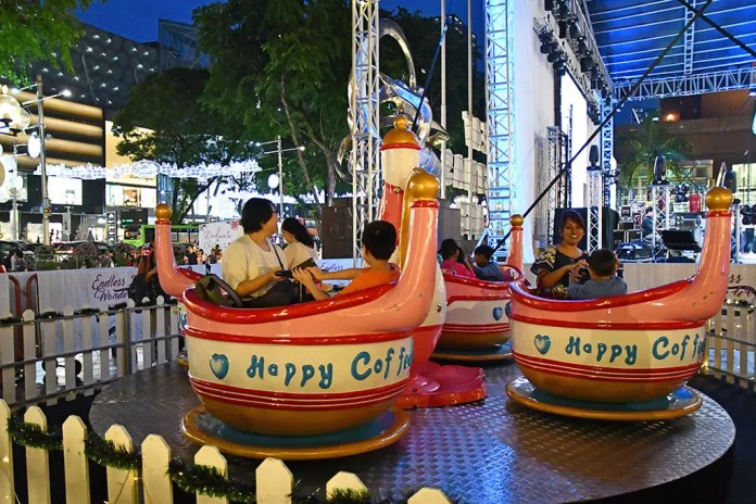 Spinning cups at Orchard Road's First Christmas Village.