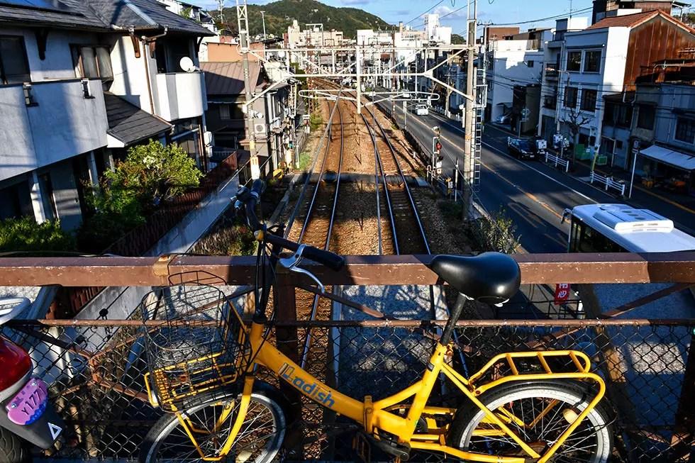 Bicycle above Onomichi train tracks.