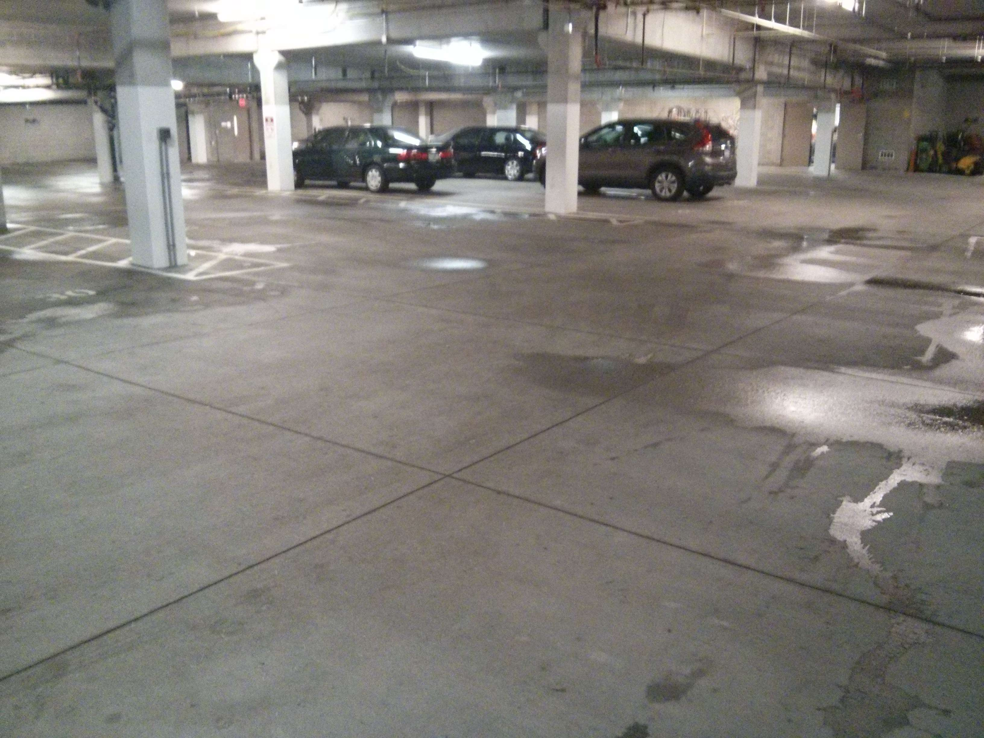 Parking garage pressure washing and mechanical scrubbing for Floor cleaning services