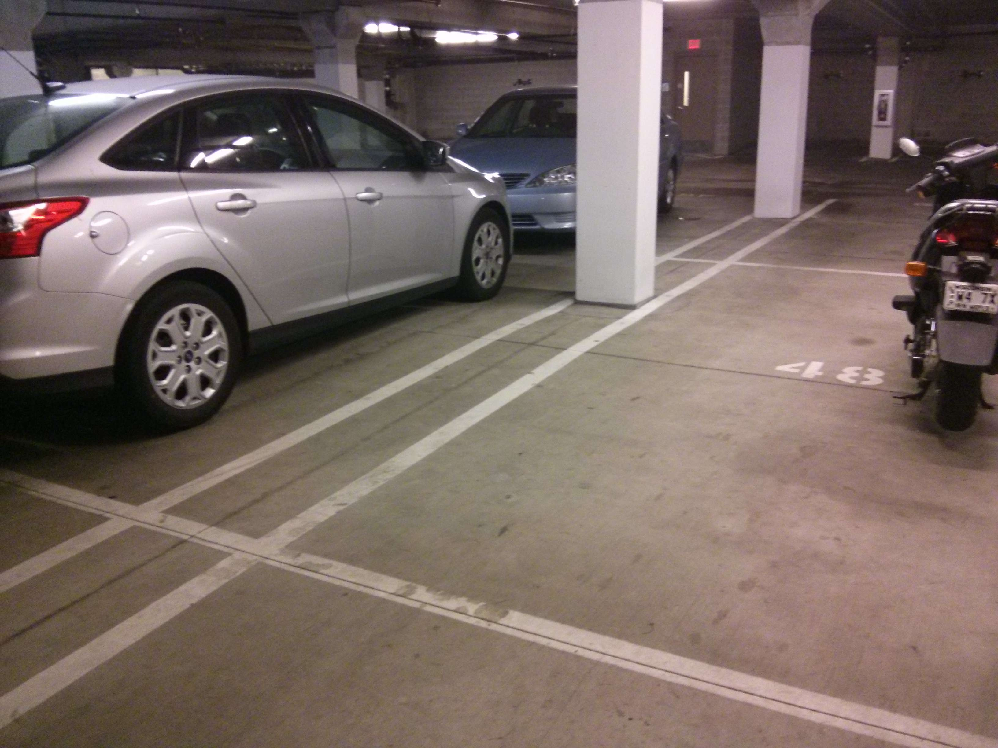 Parking garage pressure washing and mechanical scrubbing for Garage floor maintenance