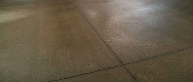 Close Up Image of Parking Garage Concrete Floor Cleaned with Scrub n Shine High Pressure Equipment