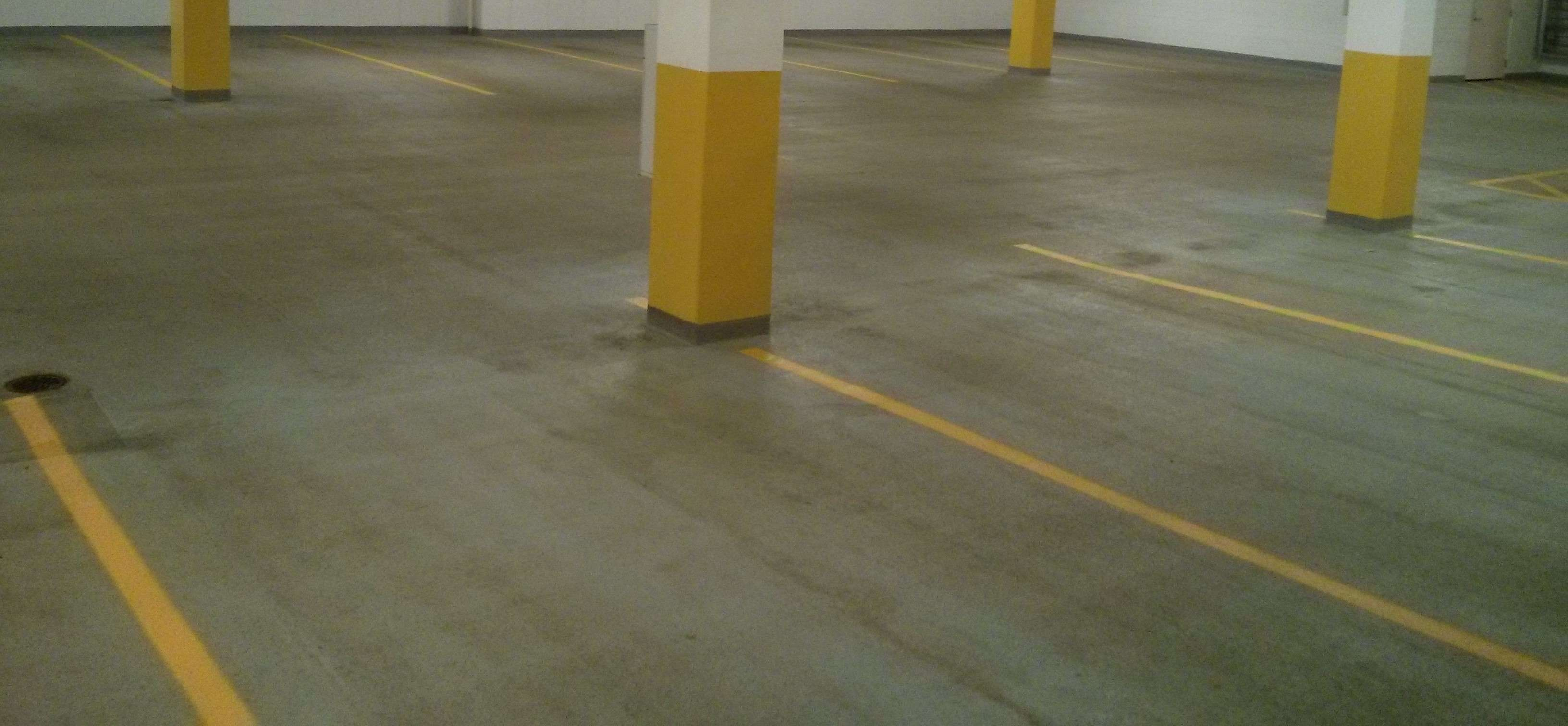 Parking garage floor cleaning and re striping job in for Garage floor cleaning companies