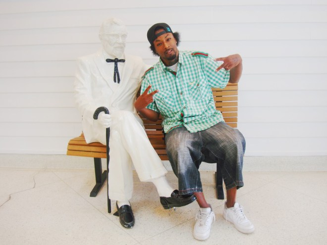 A Young Man Poses With Colonel Sanders At The Kentucky Fried Chicken Museum In Corbin Kentucky