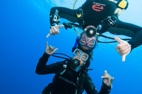 Divers Touching Heads for Photo