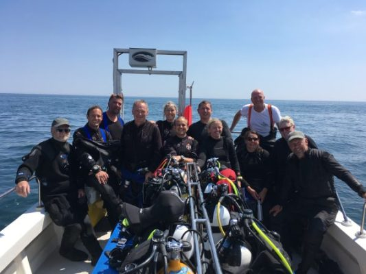 The Scuba Blue divers on Mary Jo. Happy folk after a great dive