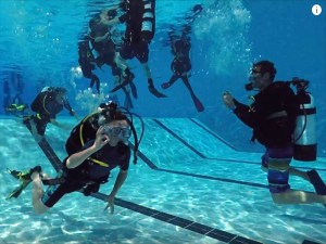 people enjoying scuba pool training