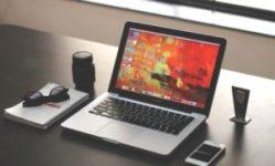 laptop on black desk