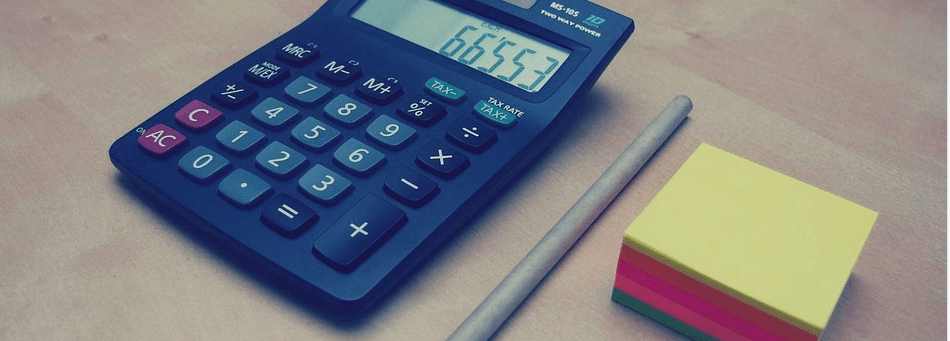 calculator pen and sticky note