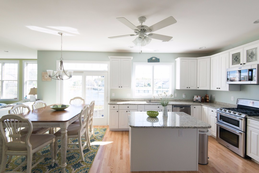 Kitchen Remodel in Bethany Lakes, Bethany Beach DE with Hardwood Flooring, Recessed Can Lights and Chandelier