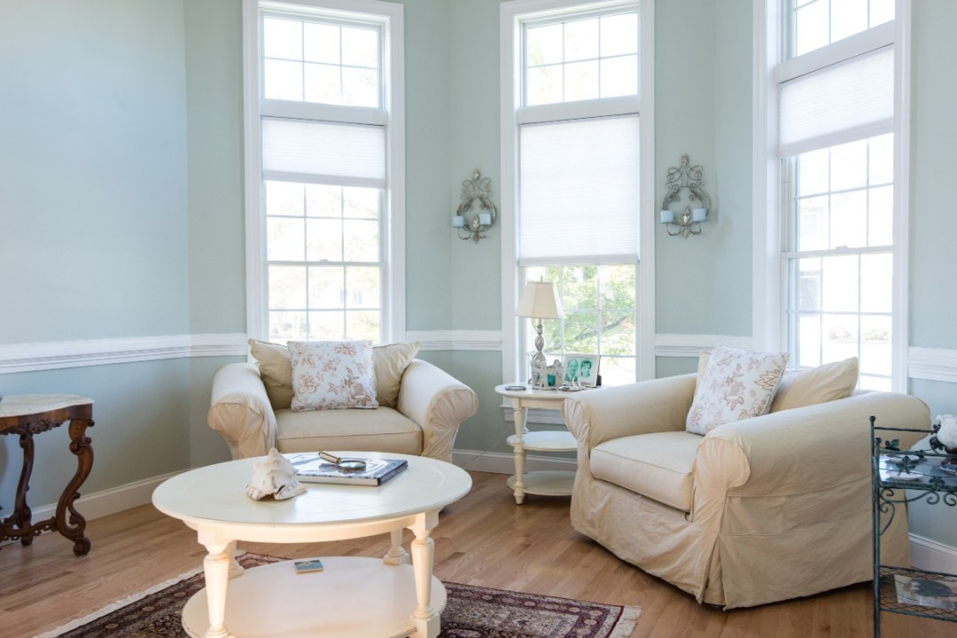 Bethany Lakes Renovation Bethany Beach, DE with Armchairs, White Round Coffee Table and Light Sea Foam Wall Paint