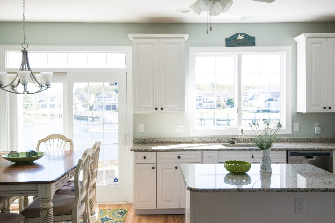 Bethany Lakes Renovation Bethany Beach, DE Cozy Kitchen with Ornament Pendant Light, Large Windows and Glass Door