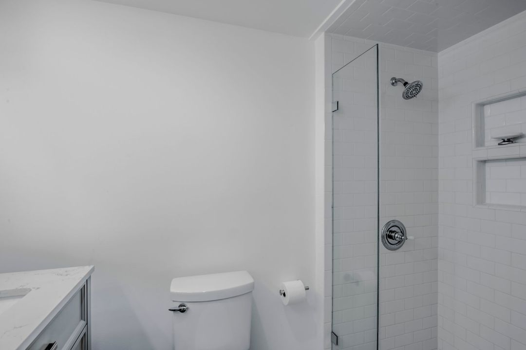 Bathroom Remodel in Campbell Place, Bethany Beach DE with White Wall Paint and Glass Shower Screen
