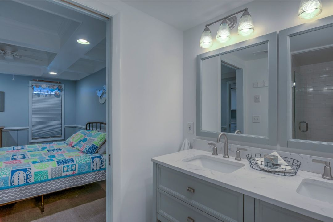 Renovation in Campbell Place, Bethany Beach DE - Bathroom with Double Vanity and Square Mirrors