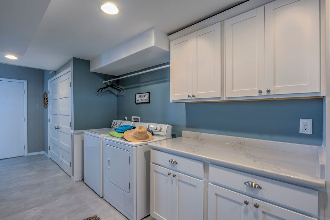 Renovation in Campbell Place, Bethany Beach DE with White Cabinets and Monterey Granite Countertop