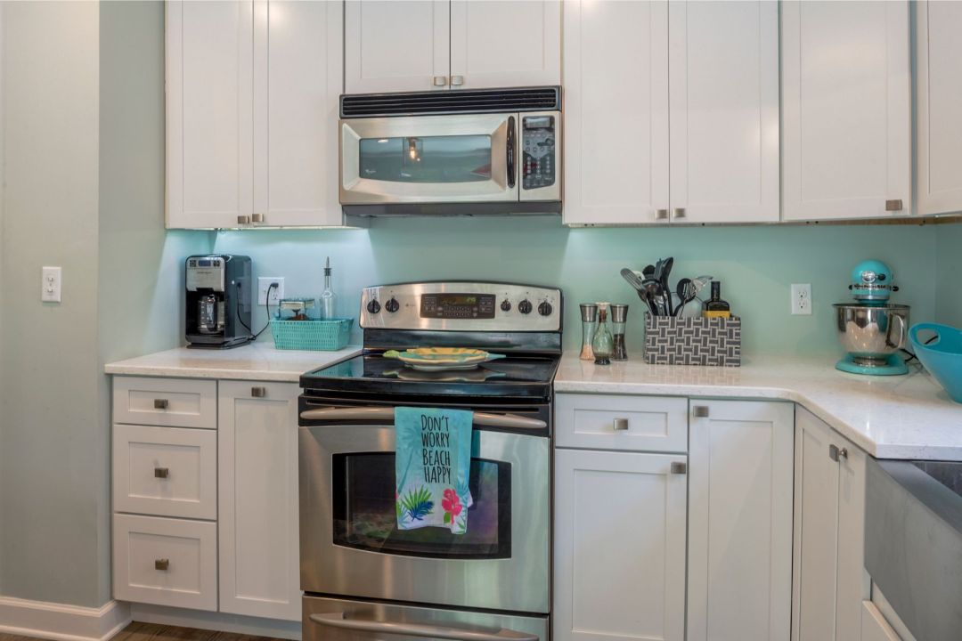 Kitchen Remodel in Canal Drive, Millsboro DE with White Cabinets and Stainless Steel Appliances