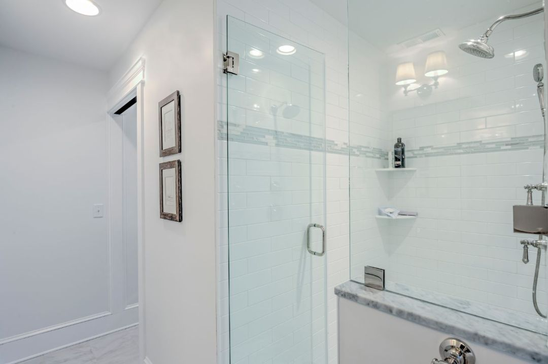 Bathroom with White Walls and Frameless Glass Shower Door