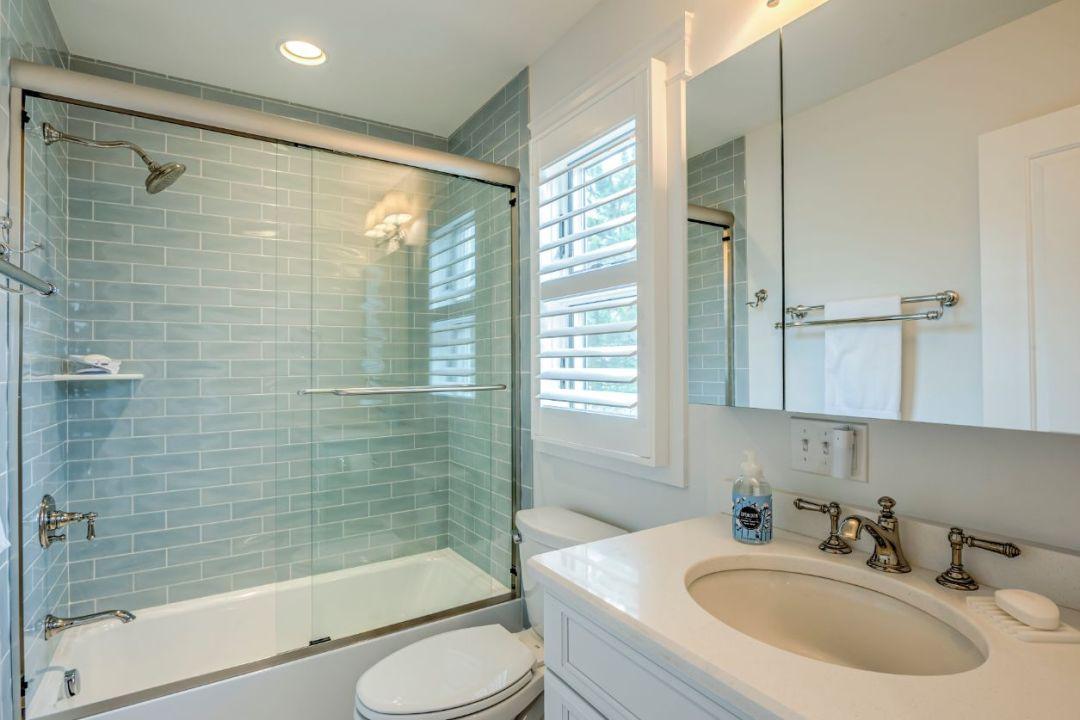 Guest Bathroom with Sliding Glass Shower Door