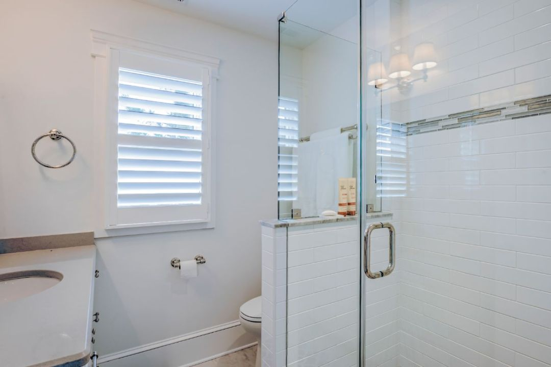 Guest Bathroom with White Walls and Frameless Glass Shower Cabin