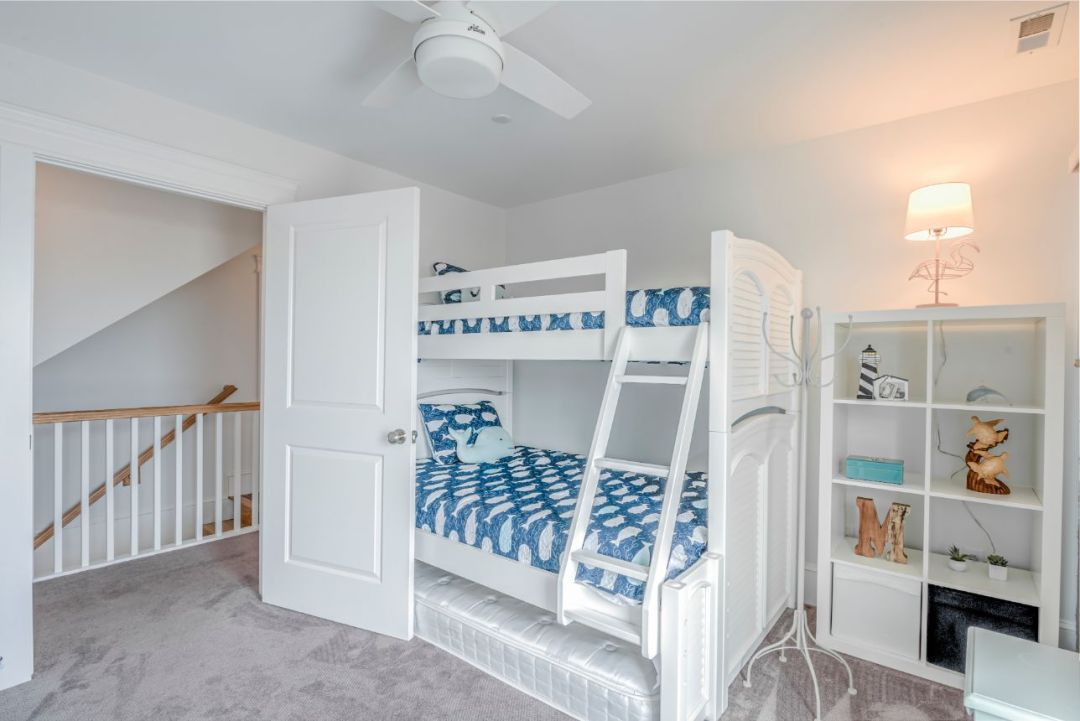 Kids Bedroom with Bunk Beds and Blue Bed Covers