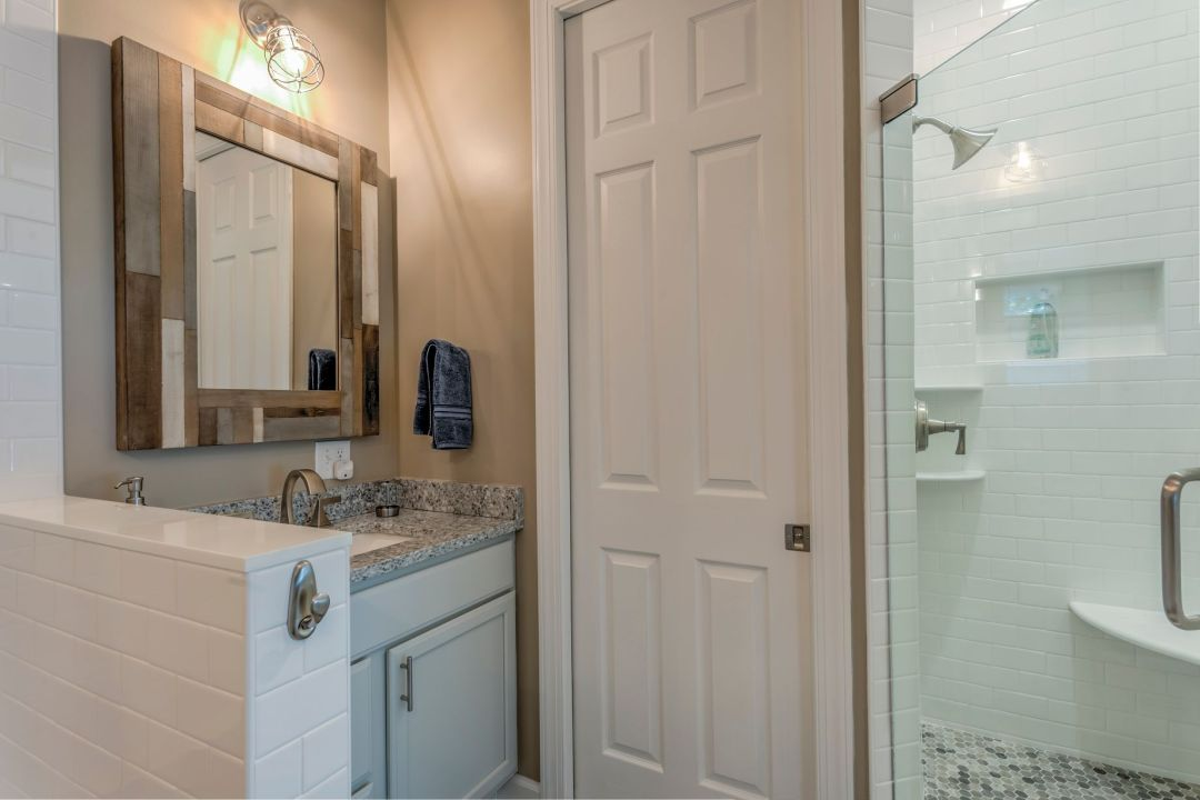 Addition in Juniper Court, Ocean Pines MD - Bathroom with Compact Sink and Large Square Mirror with Mosaic Frame