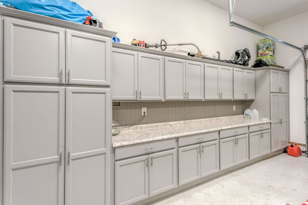 Addition in Juniper Court, Ocean Pines MD - Garage Custom Storage Area with Gray Cabinets and Granite Countertop