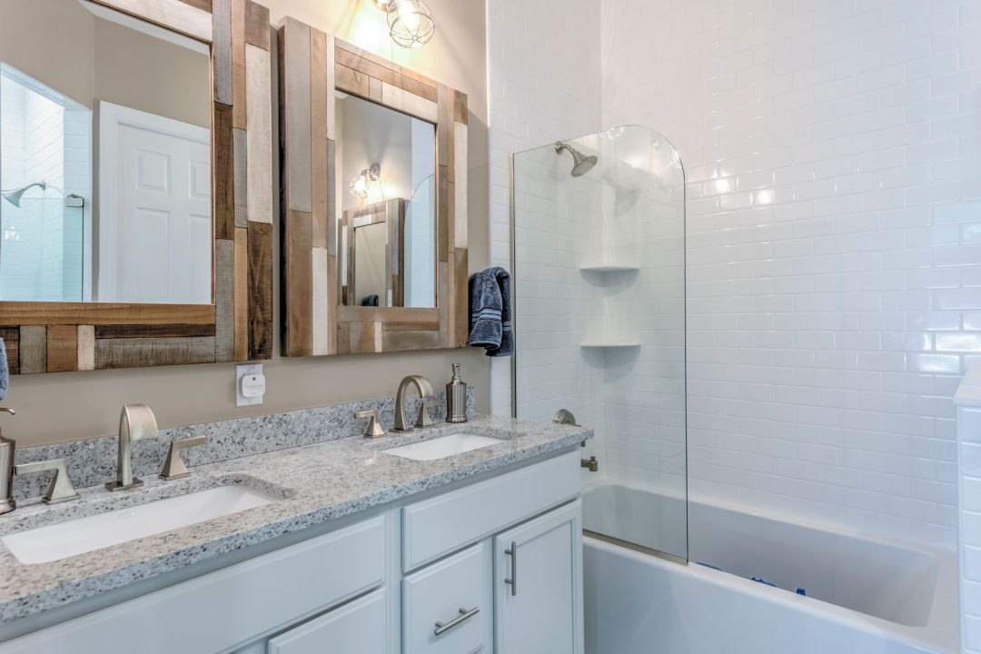 Bathroom in Juniper Court, Ocean Pines MD with Dual Sink and Two Square Mirrors with Mosaic Frames