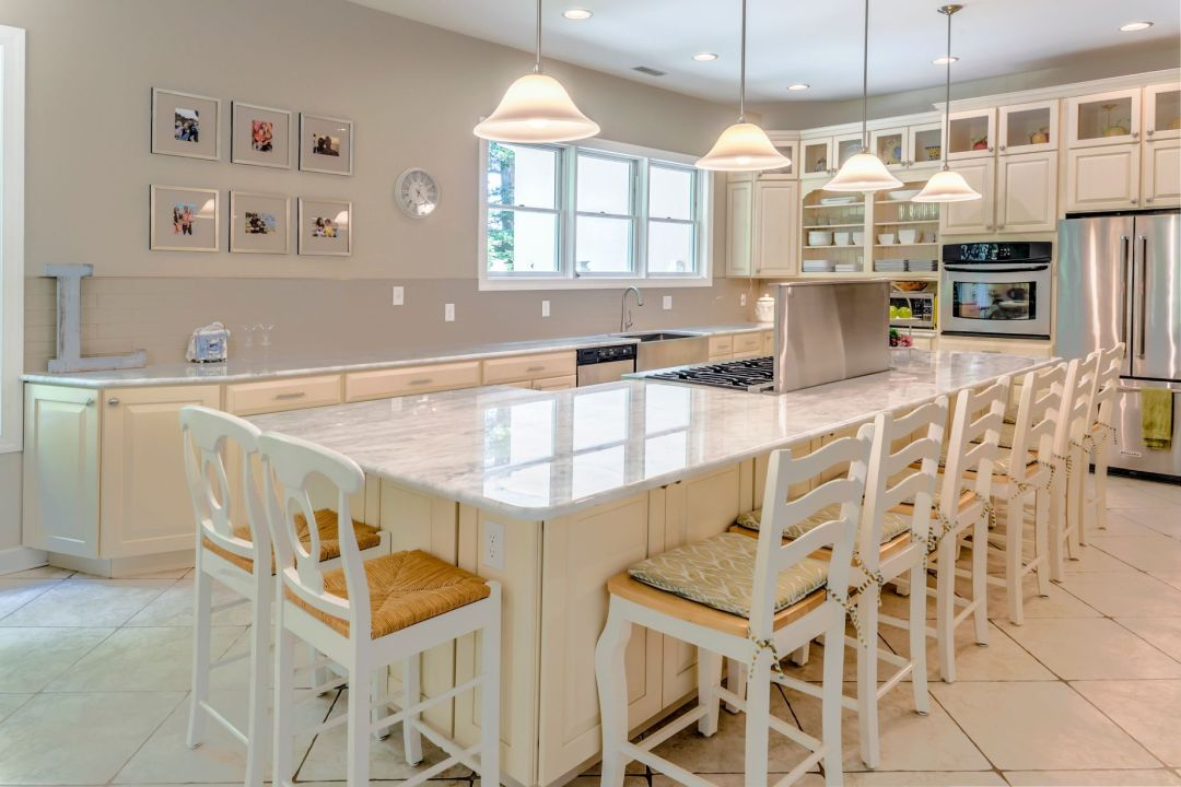 Kitchen in Juniper Court, Ocean Pines MD with Four Pendant Lights and White Chairs
