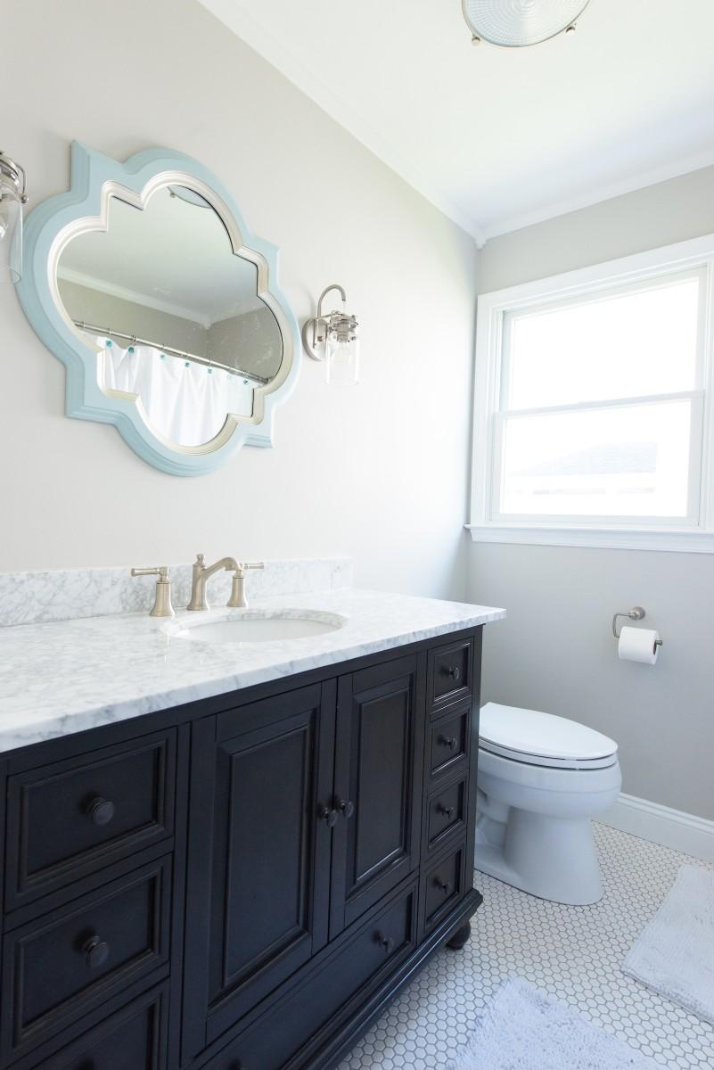 Kent Renovation Guest Bathroom with Dark Wood Vanity, Shadow Storm Granite Top, Ornament Mirror, Honeycomb White Floor Tiles
