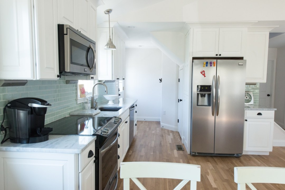 Kent Renovation Bethany Beach, DE Kitchen with White Cabinets, Shadow Storm Granite Countertop, Inox Appliances