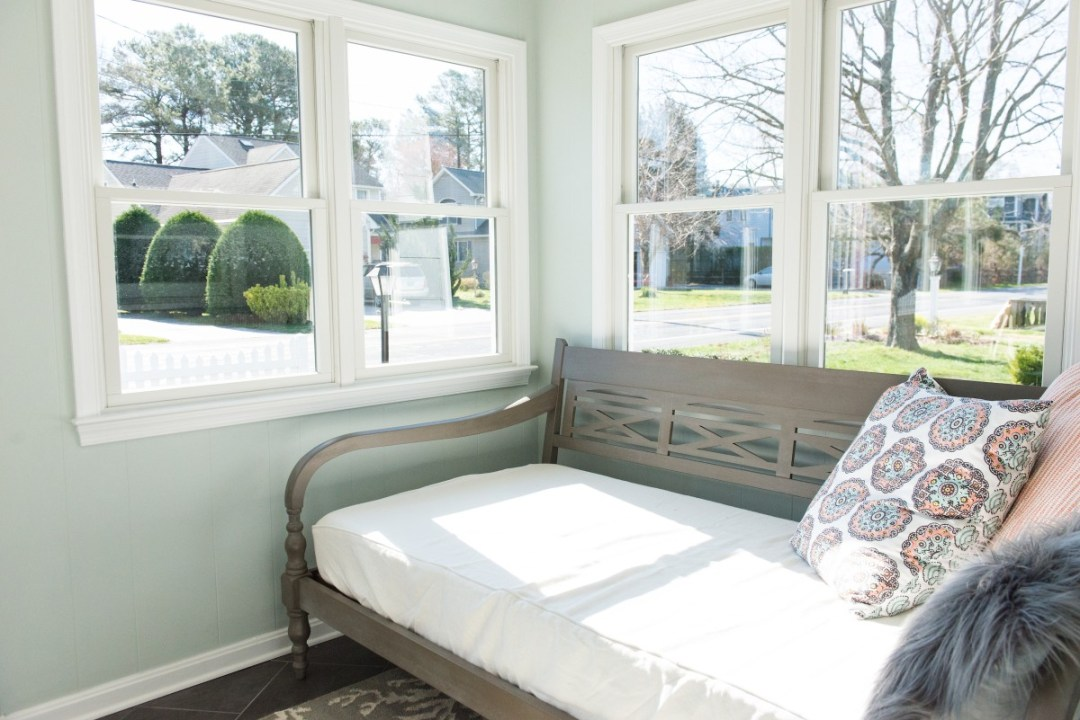 Kent Renovation Bethany Beach, DE Sunroom with Dark Wood Bench Seat with White Fabric and Light Sea Foam Wall Paint