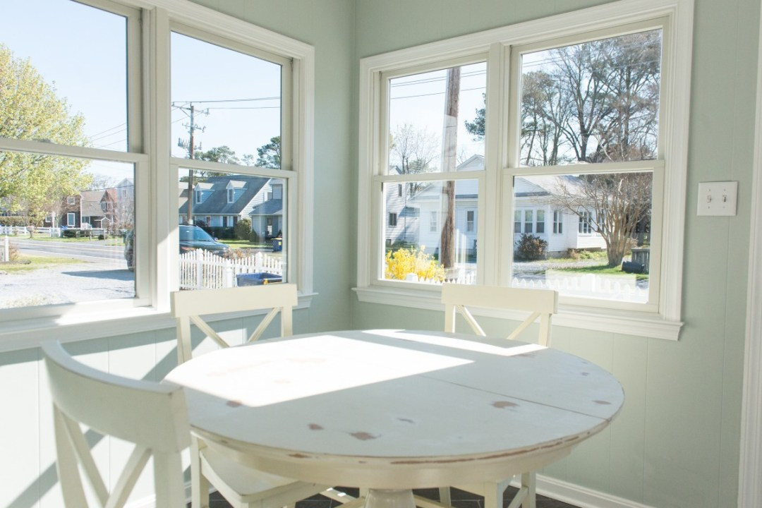 Kent Sunroom Renovation in Bethany Beach DE with White Vintage Distressed Round Table and White Windows Trim