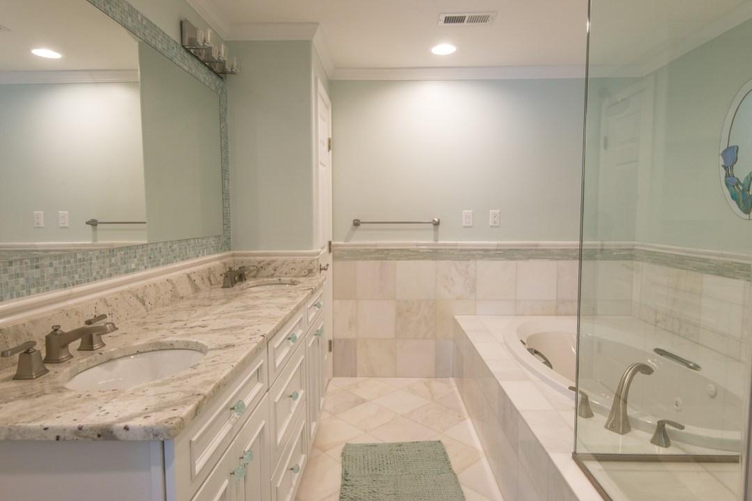 Bathroom Remodel in Kings Grant, Fenwick Island DE with White Vanities, Undermount Sinks, Granite Top, Mosaic Wall and Mirror
