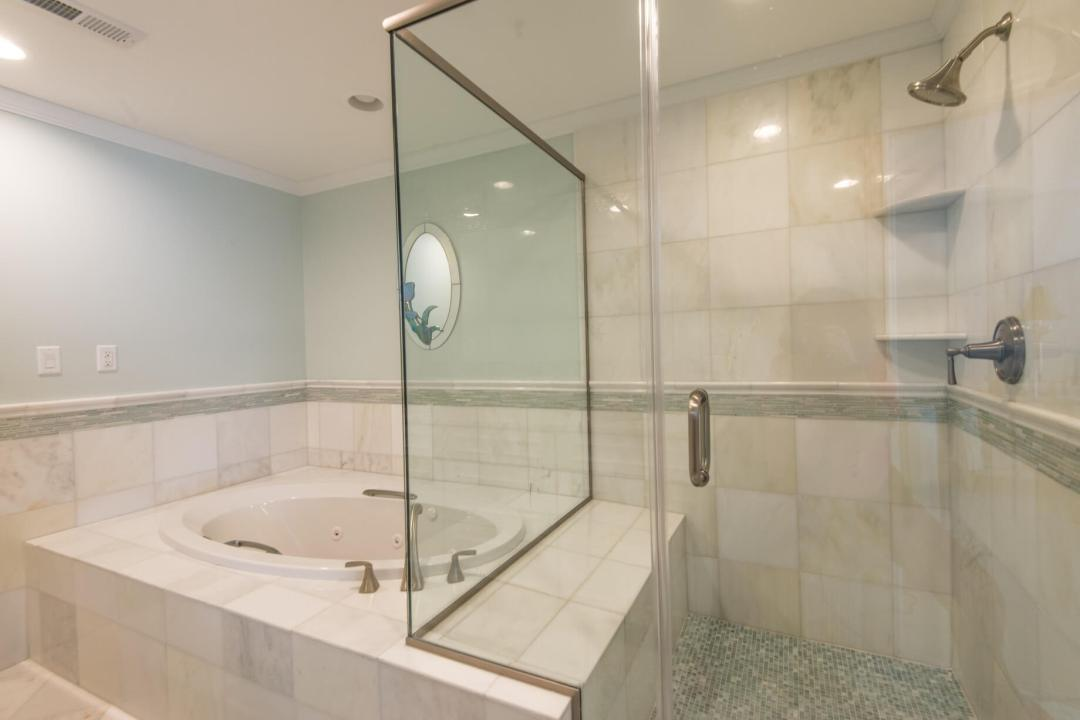 Kings Grant Renovation Vol.1 Bathroom with White Marble Wall and Floor Tiles, Tub and Frameless Glass Shower Door