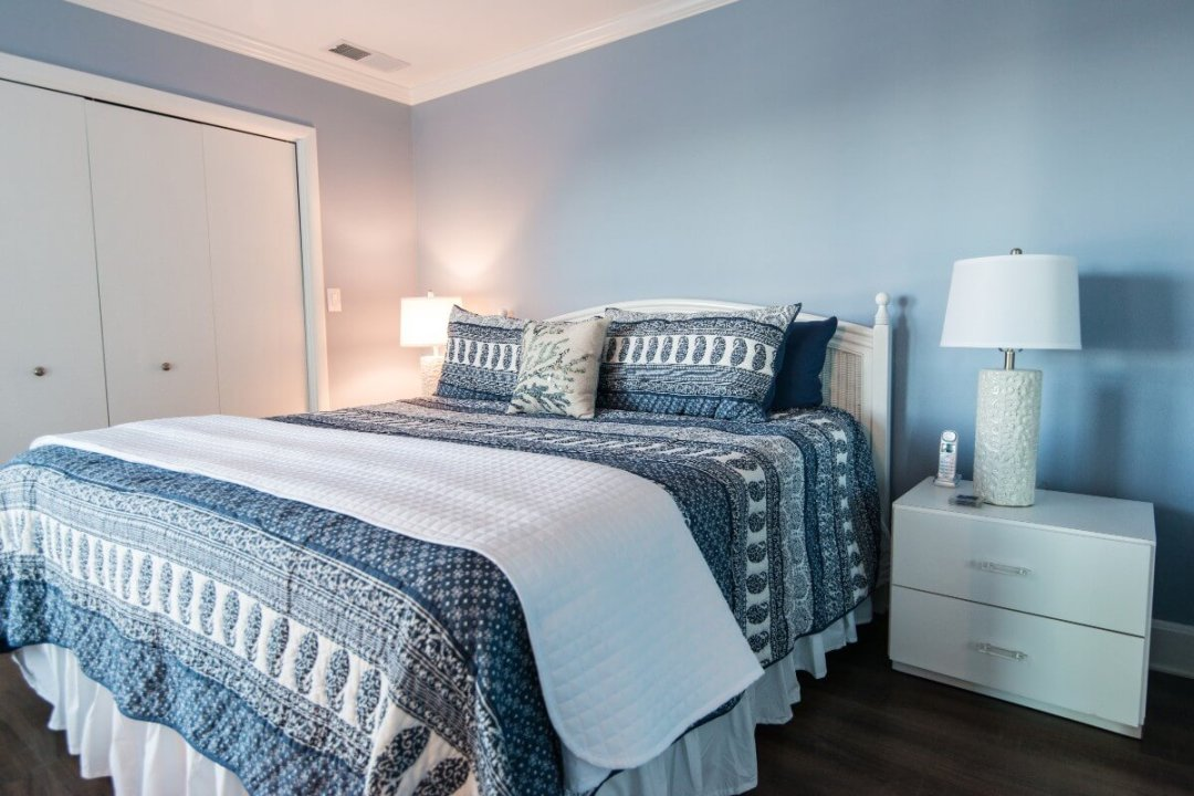 Kings Grant Renovation Vol.3 Blue Painted Bedroom with White Flat Night Stand, Dark Wood Floor and White Closet