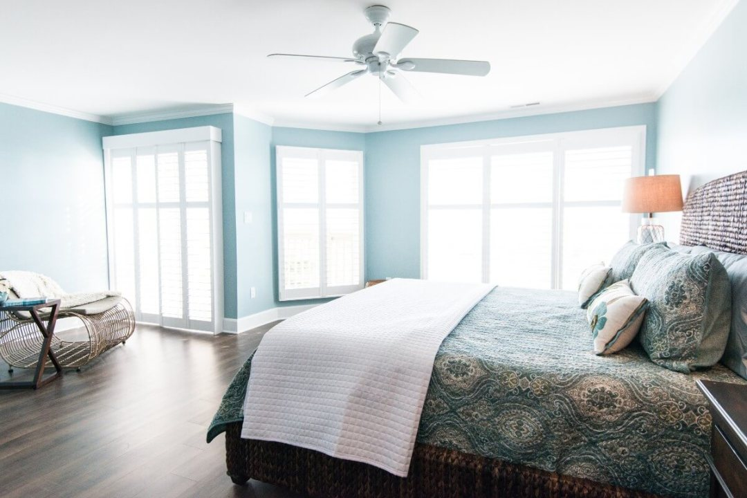 Kings Grant Renovation Vol.3 Fenwick Island, DE Light Sea Foam Painted Bedroom with Large Windows and Rocking Chair